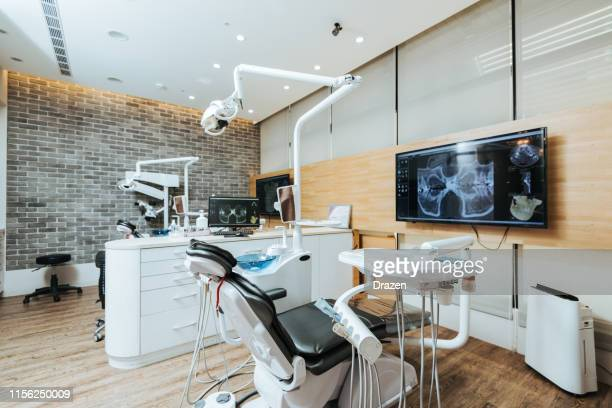 dentist office with modern equipment and microscope - dental office stock pictures, royalty-free photos & images