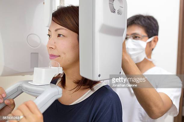 Dentist prepares patient for X-ray