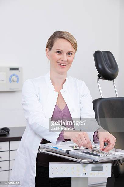 dentist preparing tools - newhealth stock photos and pictures