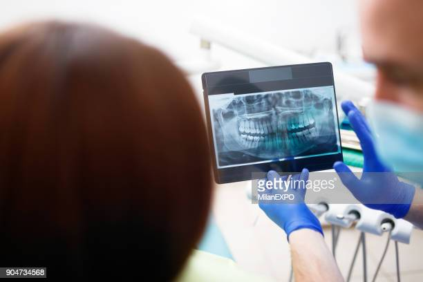 Dentist showing a patient her x-ray