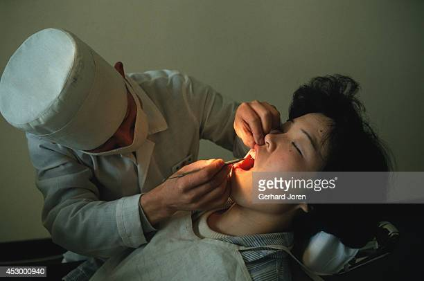 A dentist treats a patient at the Pyongyang Maternity Hospital Only selected patients are treated at this high class hospital
