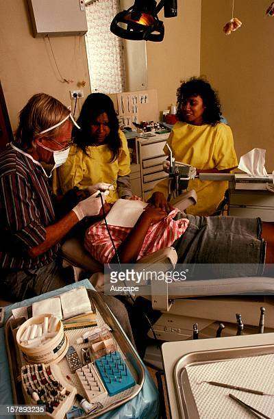 Dentist with aboriginal childat Central Australia Aboriginal Congress Medical CentreAlice Springs Northern Territory Australia