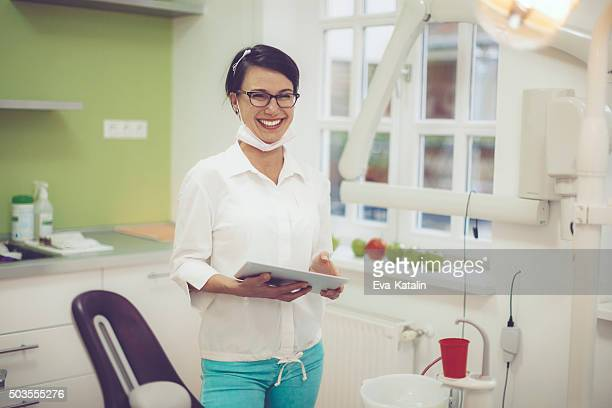 Dentist working in her office