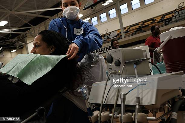 A dentist works on a patient at the Remote Area Medical mobile dental and medical clinic on December 3 2016 in Milton Florida It is expected that...