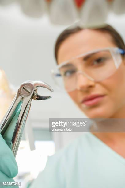 Dentistry Tooth Extraction Dentist working Dental Tooth Extraction Forceps Patient point of view
