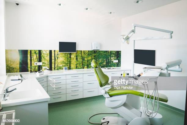 Dentist's chair in brightly lit clinic