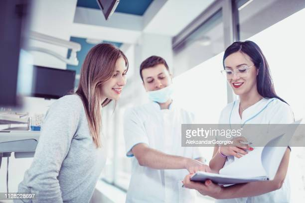 Dentists Colleagues Discussion Over New Results