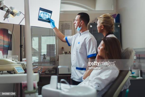 dentists examining patients teeth