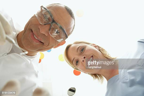 Dentists looking down at patient