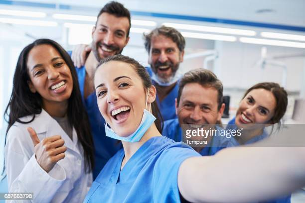 dentist's office in barcelona. medical workers portrait. - dental equipment stock pictures, royalty-free photos & images