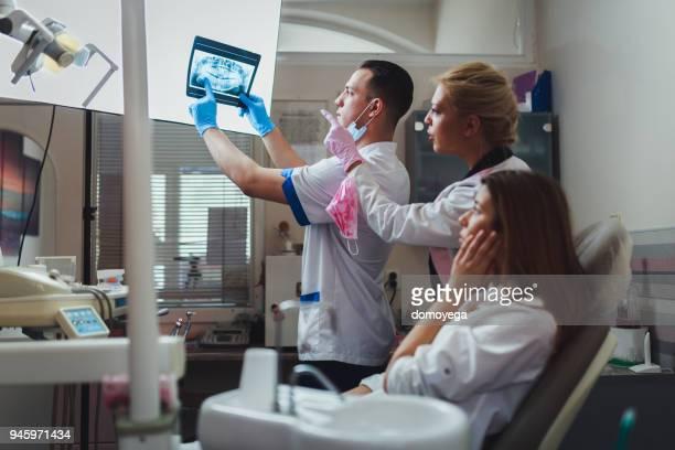 Dentists resolving a patient's problem