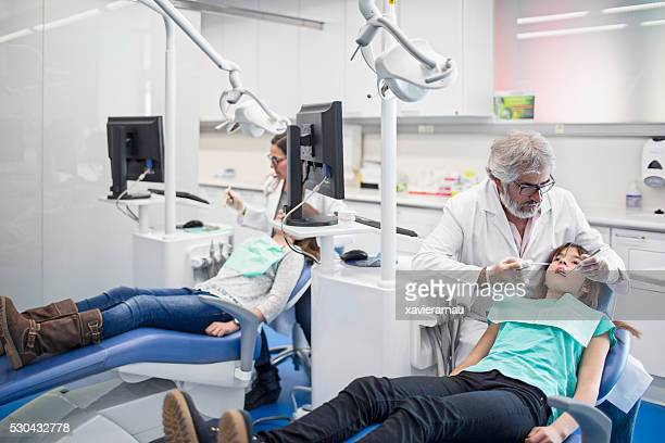 Dentists working at a dentist's surgery