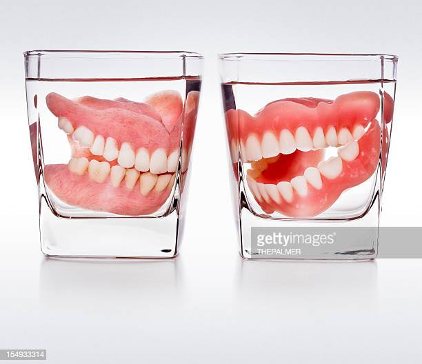 dentures in a glass of water - fake stock pictures, royalty-free photos & images