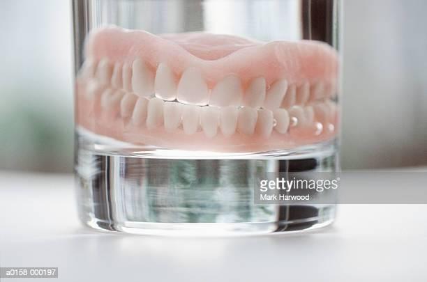 Dentures in Drinking Glass