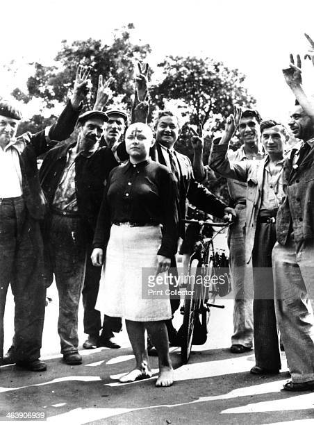 Denunciation and humiliation of a French Nazi collaborator Paris 1944 The woman has had her head shaved and has a swastika painted on her forehead...