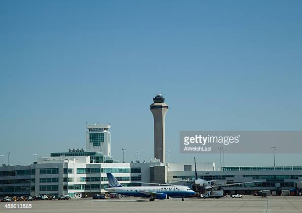 denver airport control tower on a sunny morning - denver international airport stock pictures, royalty-free photos & images