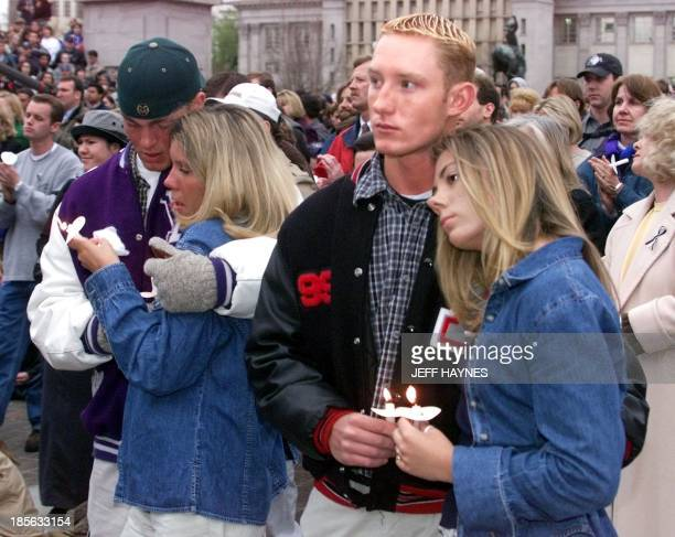 Denver area high school students Kip Ruhl Pam Wallack Dustin Koon and Kelly Derosier comfort one another 21 April 1999 during a candle light vigil at...