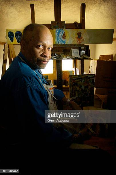 DENVER COLORADOMARCH 2 2005 Denver artist Bob Ragland is photographed in front of the easel in his attic studio where he creates many of his...