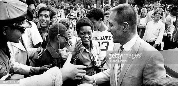 MAY 26 1970 MAY 27 1970 Denver Astronaut John L Swigert Jr gets a wild adoring welcome from students at his