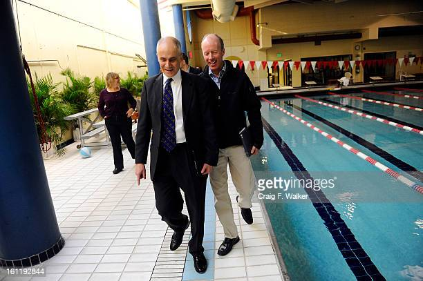 Denver Athletics Club Board Member John Golinvaux, right, walks along the pool with CEO & General Manager Andre van Hall at the club in Denver, CO,...