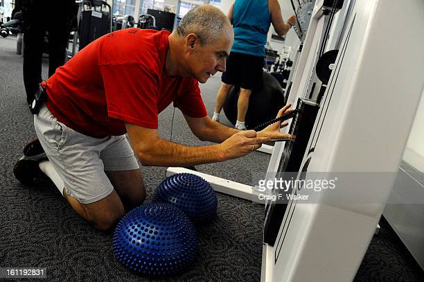 Denver Athletics Club CEO General Manager Andre van Hall changes weight during his morning workout at the club in Denver CO November 10 2011 Andre...