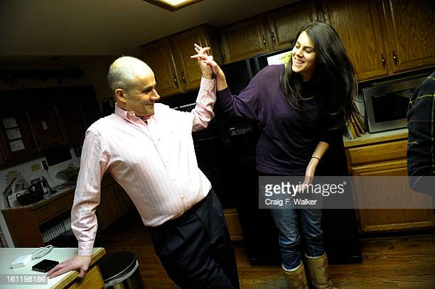 Denver Athletics Club CEO General Manager Andre van Hall gets a highfive from his daughter Anneke when he arrives home in Littleton CO Tuesday...