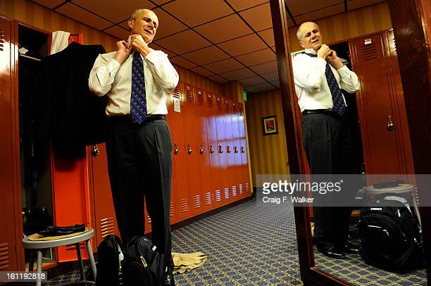 Denver Athletics Club CEO General Manager Andre van Hall struggles with his collar stays after his workout at the club in Denver CO November 10 2011...