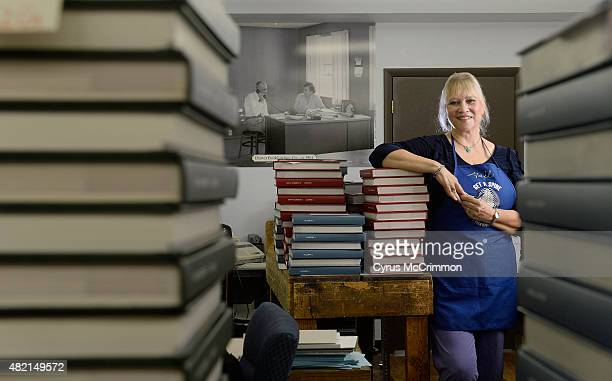 Denver Bookbinding Company CEO Gail Lindley on Monday July 27 2015 On the wall in the background is a photograph of Lindley's grandparents Axel and...