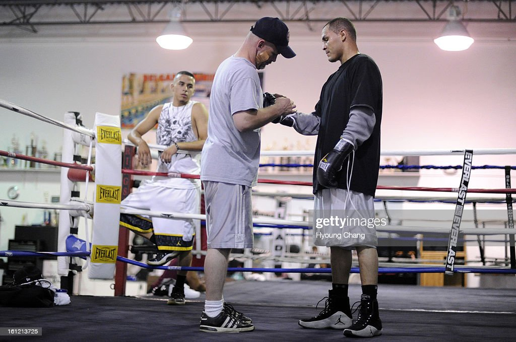 Denver boxer Mike Alvarado, front right, is in the training with his