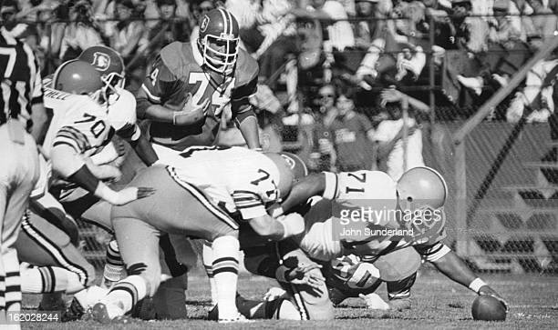 OCT 19 1975 OCT 24 1975 Denver Broncos #71 Johnson reaches out to recover loose ball in second qtr when a Charlie Johnson scream pass to upchurch...