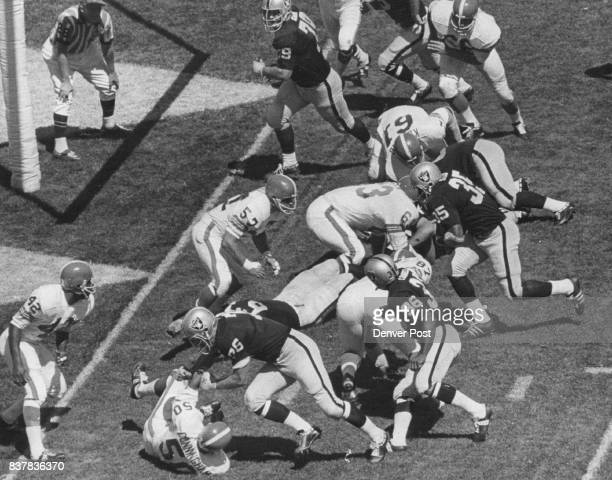Denver Broncos Action Oakland's Hewritt Dixon Crashes over from three near end of first period To get 510 rout of Broncos under way ***** blockers...