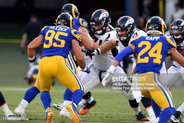Denver Broncos Austin Schlottmann working at center and offensive guard Don Barclay blocking as the Denver Broncos take on the Los Angeles Rams at...