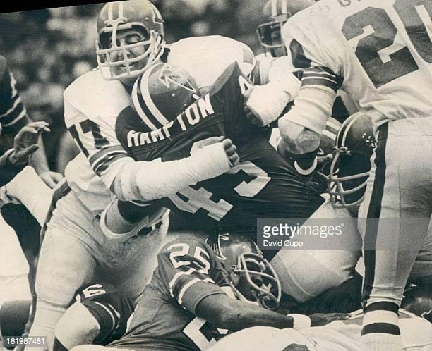 NOV 26 1972 NOV 27 1972 DEC 3 1972 Denver Broncos Bronco defensive end Lyle Alzado wraps up Atlanta running back Dave Hampton Underneath Hampton is...
