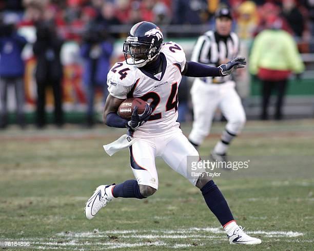 Denver Broncos CB Champ Bailey runs back an interception ten yards in the second quarter at Arrowhead Stadium in Kansas City Missouri on December 4...