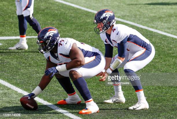 Denver Broncos center Lloyd Cushenberry and Denver Broncos quarterback Drew Lock practice snaps in warm up before a game between the New England...