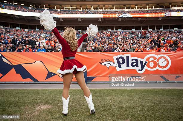 Denver Broncos cheerleader performs in a Christmasthemed outfit during a game between the Denver Broncos and the Buffalo Bills at Sports Authority...