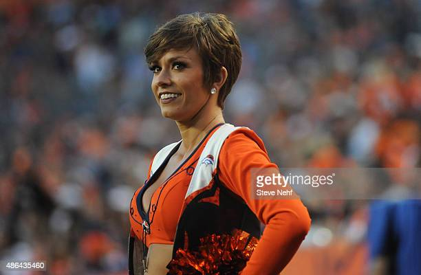 Denver Broncos cheerleaders kept smiling through the final preseason game against the Arizona Cardinals at Sports Authority Field at Mile High on...