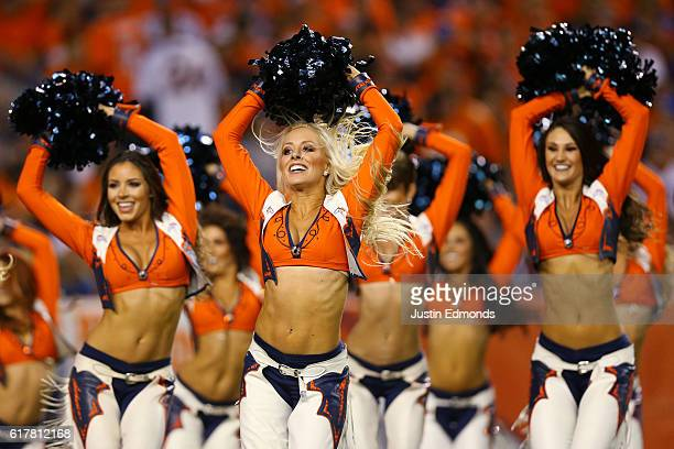 Denver Broncos cheerleaders perform after the first quarter of the game against the Houston Texans at Sports Authority Field at Mile High on October...