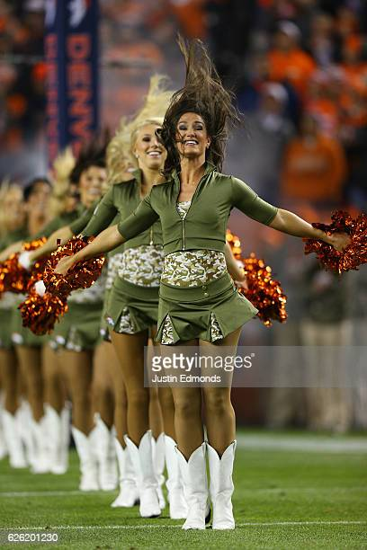 Denver Broncos cheerleaders perform before the game against the Kansas City Chiefs at Sports Authority Field at Mile High on November 27 2016 in...