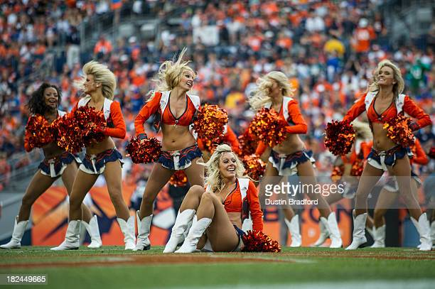 Denver Broncos cheerleaders perform during a break in the game between the Denver Broncos and the Philadelphia Eagles at Sports Authority Field Field...