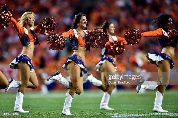 Denver Broncos cheerleaders perform during a game between the Denver Broncos and the Carolina Panthers at Sports Authority Field at Mile High on...