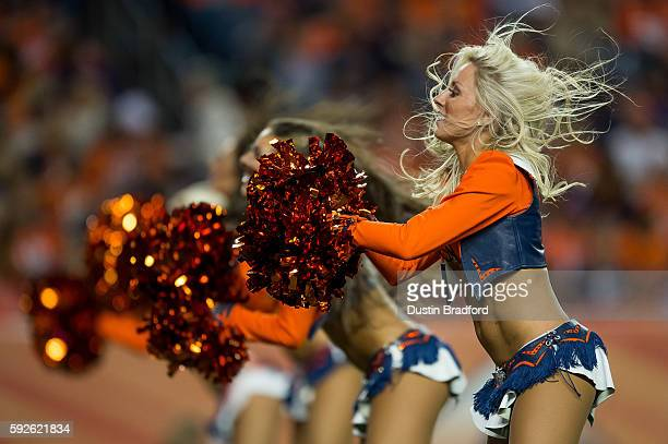 Denver Broncos cheerleaders perform during a preseason NFL game between the Denver Broncos and the San Francisco 49ers at Sports Authority Field at...