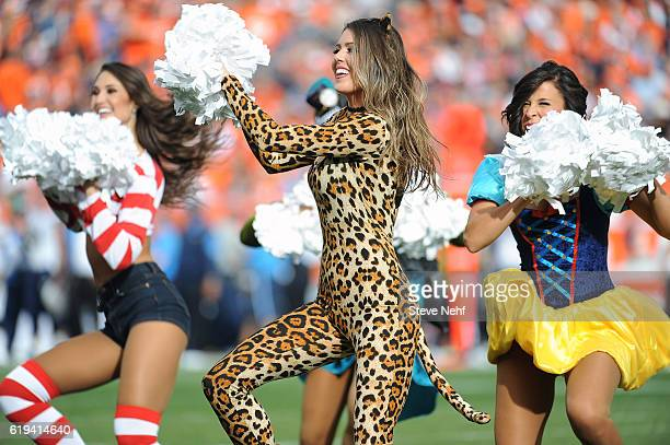 Denver Broncos cheerleaders perform in Halloween costumes during the game against the San Diego Chargers at Sports Authority Field at Mile High on...