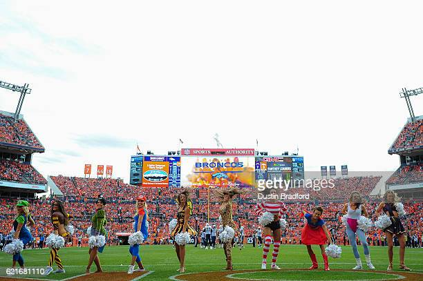 Denver Broncos cheerleaders perform in halloween costumes in the first quarter of a game between the Denver Broncos and the San Diego Chargers at...