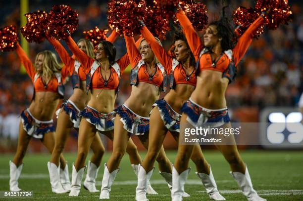 Denver Broncos cheerleaders perform in the fourth quarter during a preseason NFL game between the Denver Broncos and the Arizona Cardinals at Sports...