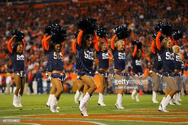 Denver Broncos cheerleaders perform wearing 509 jerseys celebrating quarterback Peyton Manning's record setting 509th career touchdown pass during a...