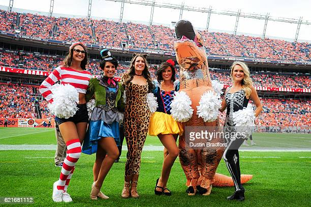 Denver Broncos cheerleaders pose for a photo in costume before a game between the Denver Broncos and the San Diego Chargers at Sports Authority Field...