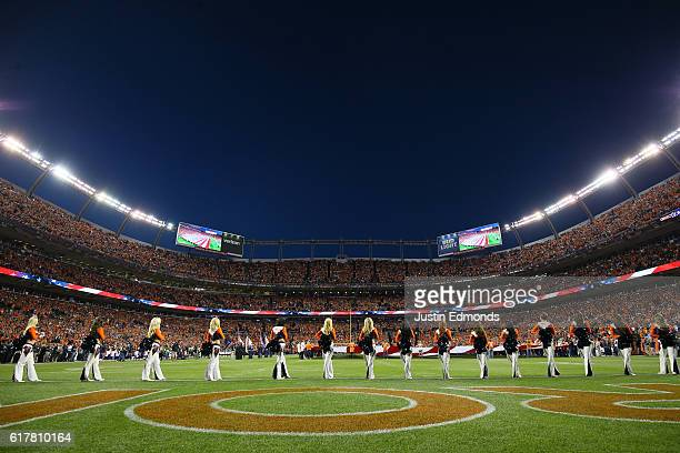 Denver Broncos cheerleaders stand in formation for the National Anthem before the game against the Houston Texans at Sports Authority Field at Mile...