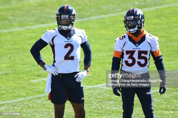 Denver Broncos corner backs Pat Surtain II , left, and Kary Vincent Jr. Are on the field for the team practice at UCHealth Training Center in...