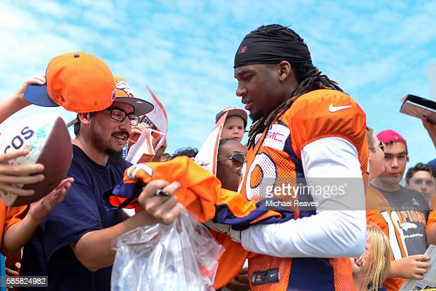 Denver Broncos cornerback Bradley Robey signs a jersey for a fan after practice at training camp on August 2016 in Dove Valley